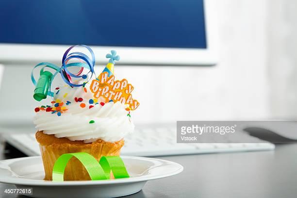 Birthday cupcake on desk