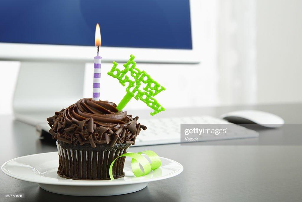 Birthday cupcake on desk : Stock Photo