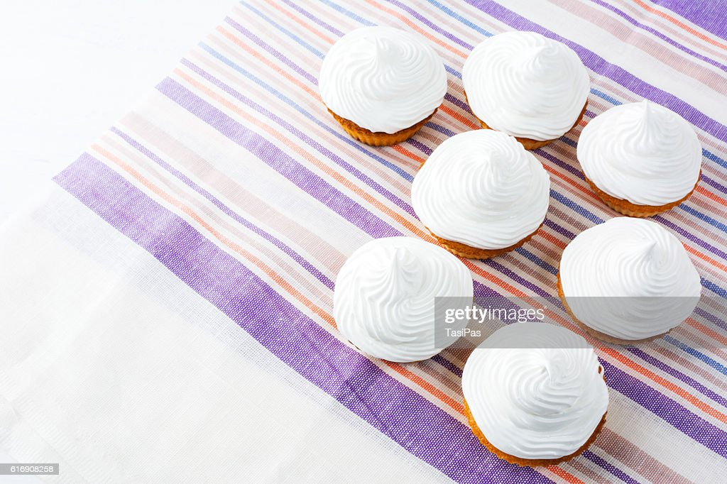 Birthday cupcakes with white whipped cream, top view, copy space : Stock Photo