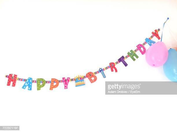 Birthday Decoration And Balloons Against White Background