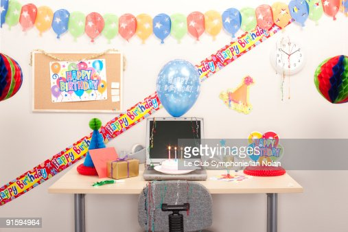 Birthday Decorations At Workstation Stock Photo