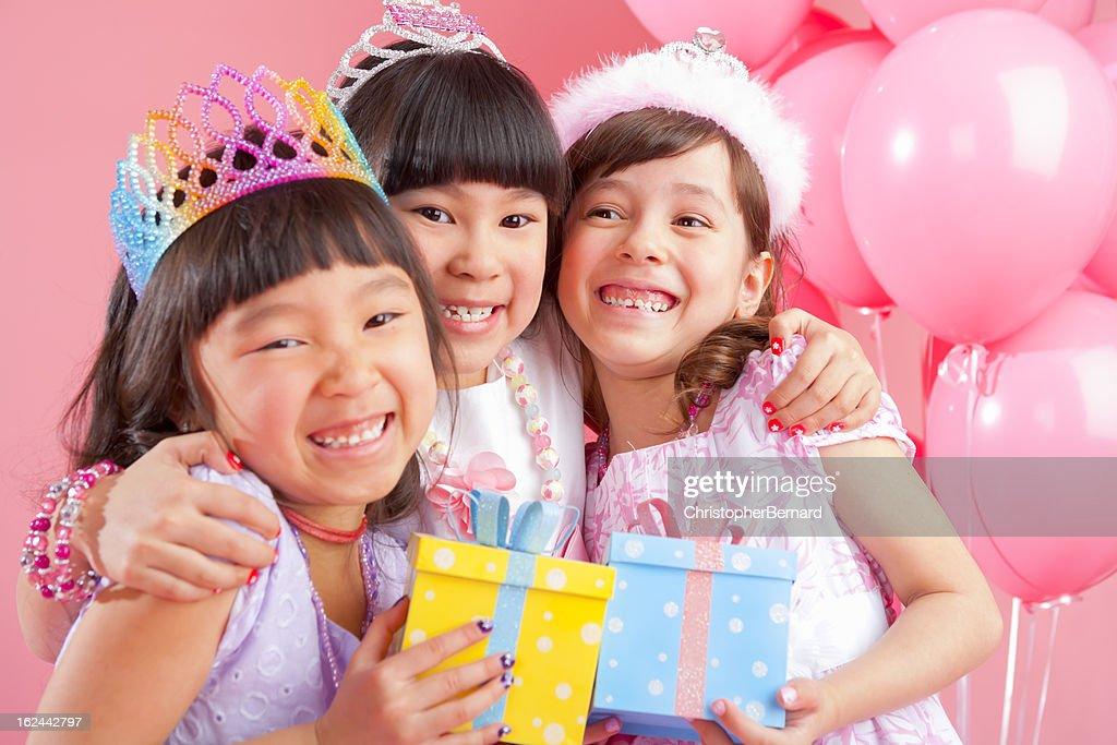 Birthday girl celebrating with friends : Stock Photo