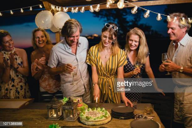 birthday girl cutting into her cake - gazebo stock pictures, royalty-free photos & images
