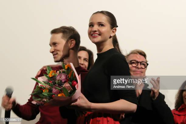 Birthday girl Lisa Vicari receives a bouquet of flowers from show runner Oliver Kienle during the premiere of the Netflix film Isi Ossi at...