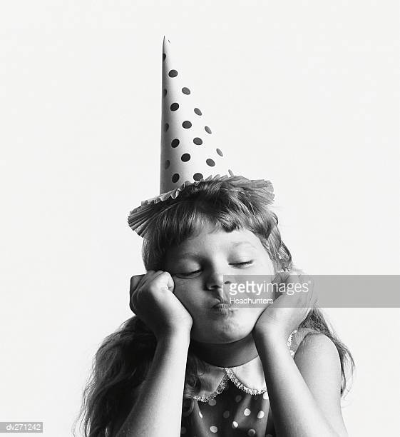 birthday girl with head in hands - headhunters stock pictures, royalty-free photos & images