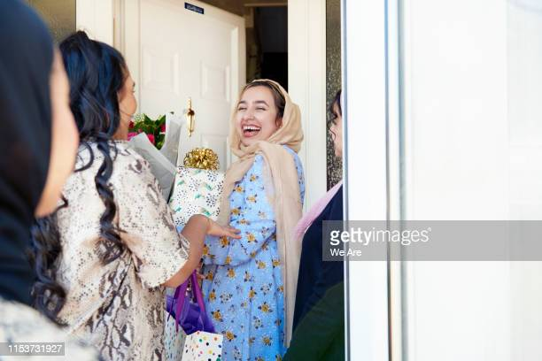 birthday guests arriving with gifts - islam stock pictures, royalty-free photos & images