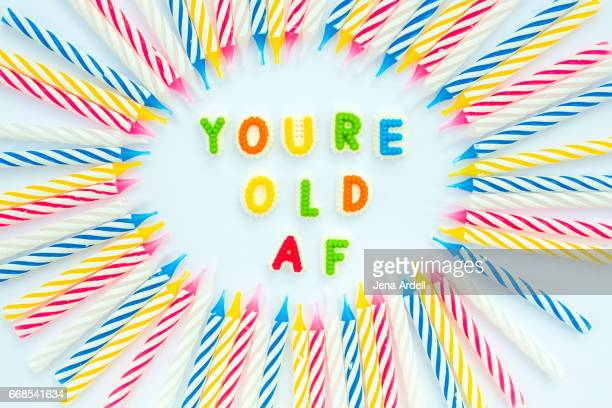 birthday humor, you're old af - birthday cake lots of candles stock photos and pictures