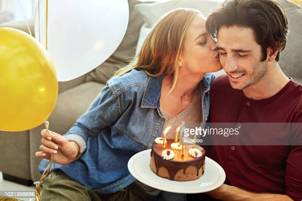 birthday kisses for the birthday boy - heterosexual couple stock pictures, royalty-free photos & images