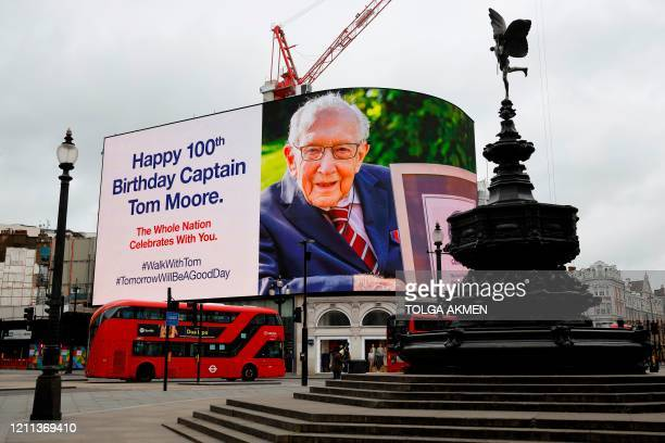 Birthday message for Captain Tom Moore is displayed on the advertising boards in Piccadilly Circus in London on April 30, 2020 as the country...