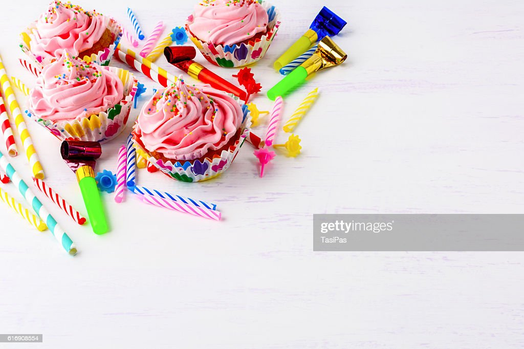 Birthday party background with pink buttercream frosting cupcake : Stock Photo