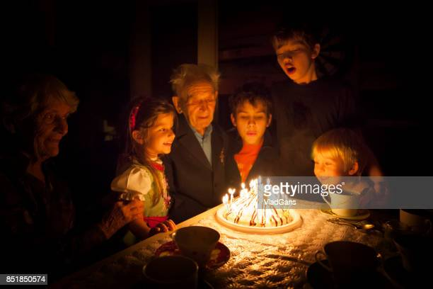 birthday party for great grandparent - birthday candles stock photos and pictures