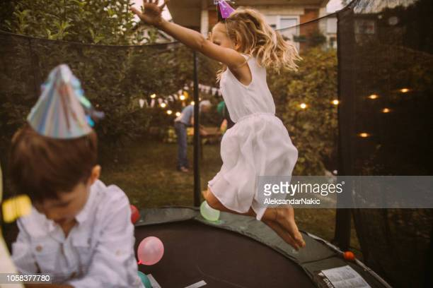 birthday party on a trampoline - birthday party stock pictures, royalty-free photos & images