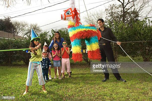 birthday party outdoors with pinata - pinata stock pictures, royalty-free photos & images
