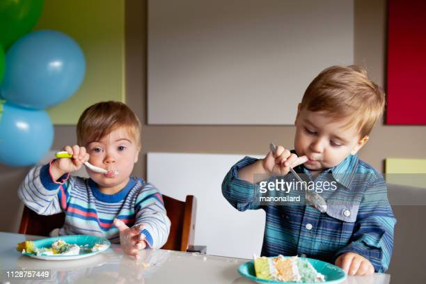 birthday party with little boy with down syndrome - children only stock pictures, royalty-free photos & images