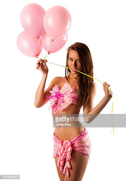 birthday present girl ready to unwrap - birthday balloons stock photos and pictures