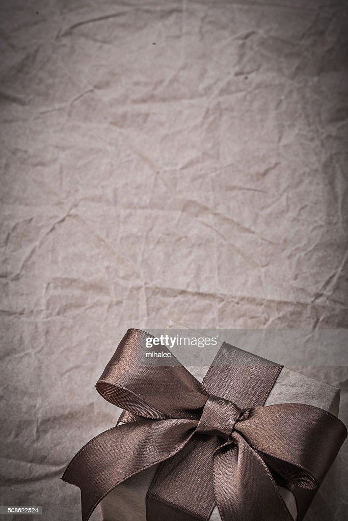 Birthday present with bow on wrapping paper copyspace holidays c : Stock Photo