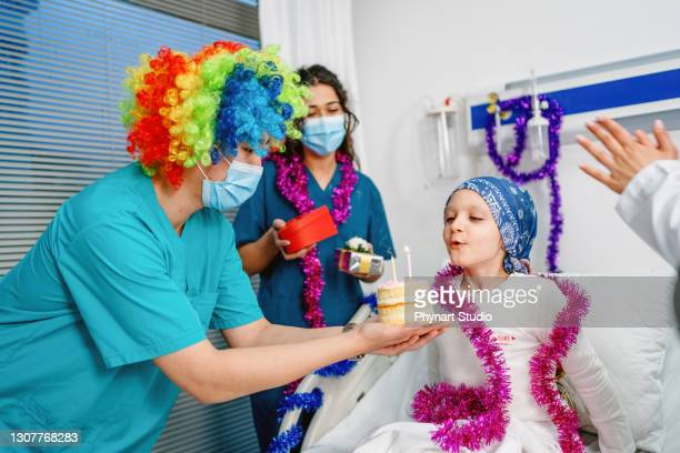 birthday surprise for little girl in hospital room - cancer illness stock pictures, royalty-free photos & images
