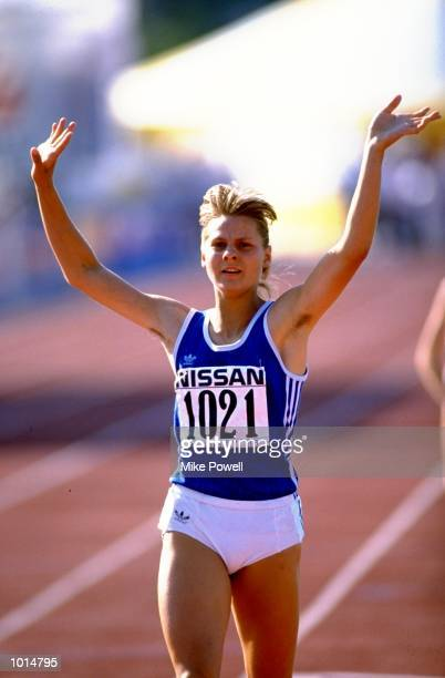 Birthe Bruhns of East Germany holds her arms aloft in celebration as she crosses the line to win the Womens 800 metres event during the World Junior...