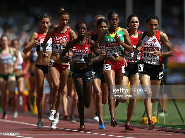 Birtukan Fente of Ethiopia and Ozlem Kaya of Turkey compete in the Women's 3000 metres steeplechase heats during day three of the 15th IAAF World...