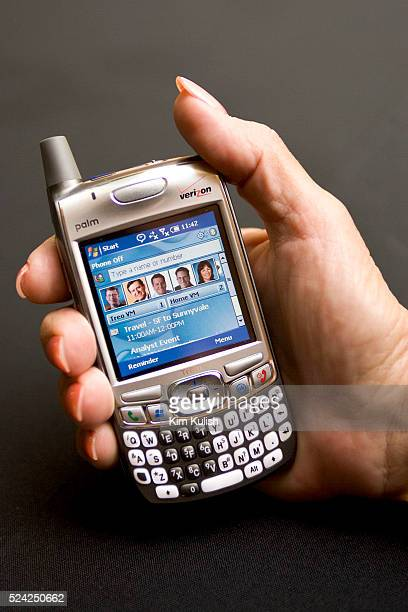 Biruta McShane of Palm Inc holds up the new Palm Treo smart phone following a joint news conference with Microsoft Corp Sept 26 2005 in San Francisco...