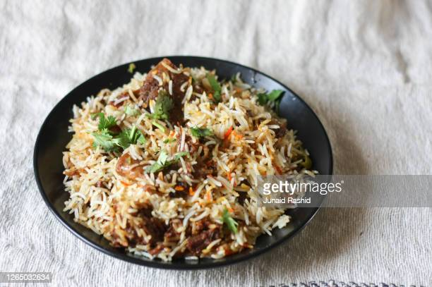 biryani beef and mutton rice closeup with garnish - beef stock pictures, royalty-free photos & images