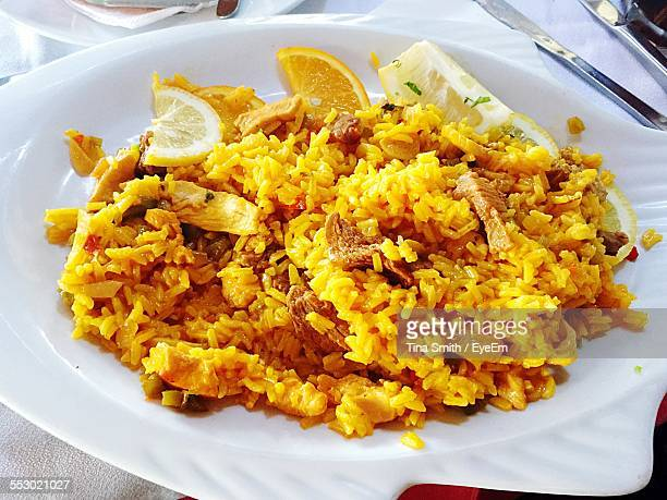 biryani served in plate - biryani stock photos and pictures
