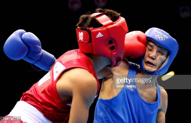 Birzhan Zhakypov of Kazakhstan in action with Mark Barriga of Philippines during the Men's Light Fly 4649kg_ Boxing on Day 8 of the London 2012...
