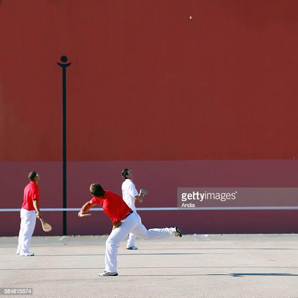 people playing Basque pelota