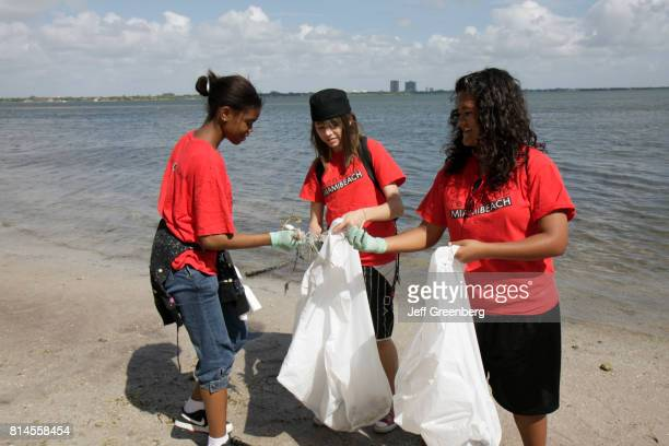 Biscayne Bay Cleanup Day volunteers picking up trash
