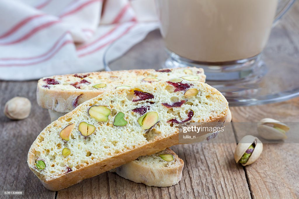Biscotti with cranberry and pistachio with cup of coffee latte : Stock Photo