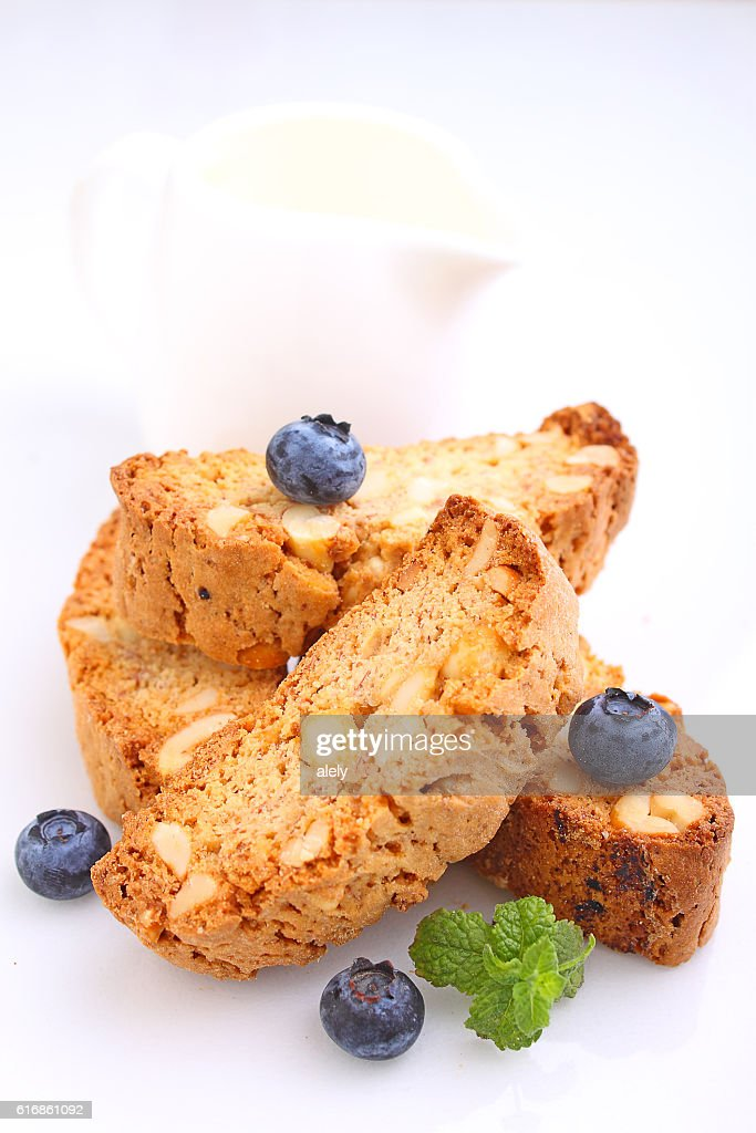 Biscotti with nuts on a white background. selective focus : Stock Photo