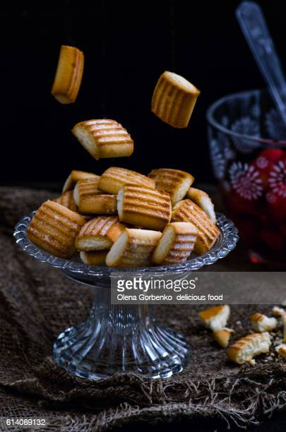 Biscuit cookies and strawberry on a dark background. Levitation