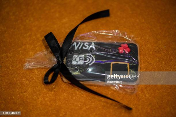 A biscuit iced to look like a debit card sits on display during the launch of the National Westminster Bank Plc biometric debit card in London UK on...