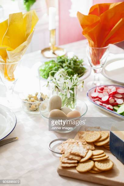 Biscuits, eggs and radish on table
