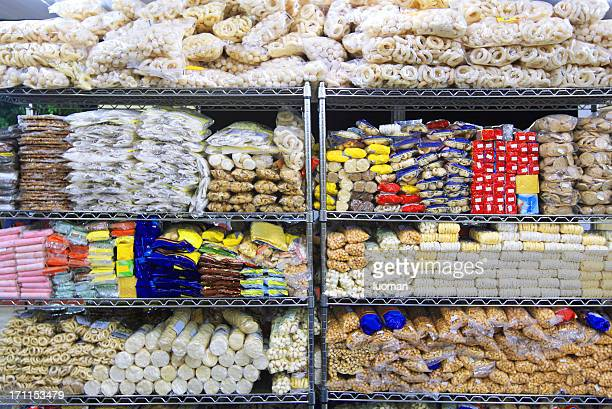 biscuits in a supermarket - convenience store stock photos and pictures
