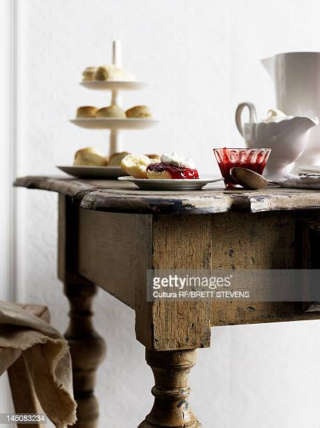 Biscuits with jam on wooden table