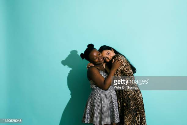 bisexual couple hugging - lesbian stock pictures, royalty-free photos & images