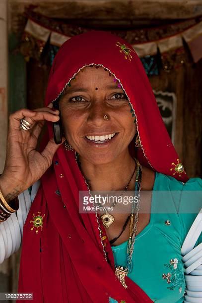 Bishnoi woman using mobile phone, Rajasthan, India