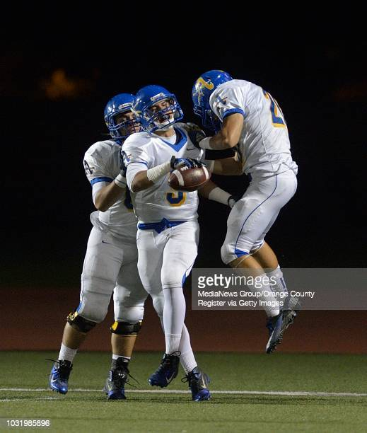 BEACH CALIF USA Bishop Amat's Anthony Camargo celebrates a touchdown against Poly in Long Beach Calif on November 9 2012