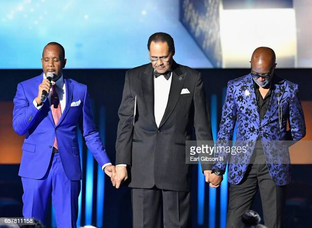 Bishop Charles Ellis Central City Chairman/CEO Don Jackson and host Jonathan Slocumb stand onstage for the invocation during the 32nd annual Stellar...