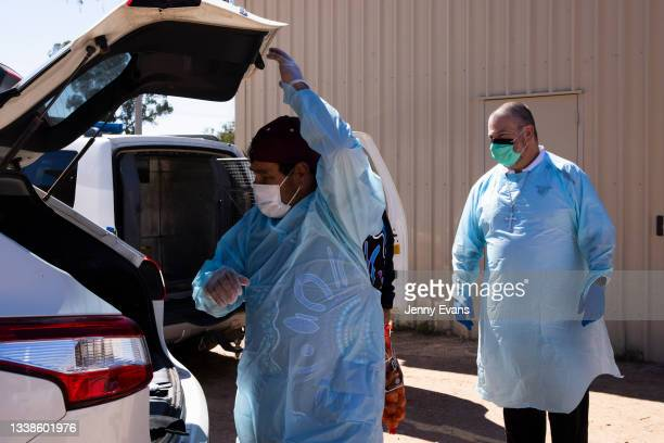 Bishop Columba and Brendon Adams pack items into their car ahead of a food distribution to the community on September 06, 2021 in Wilcannia,...