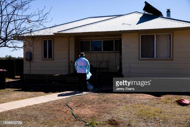 Bishop Columba distributes toilet paper to a member of the community on September 06, 2021 in Wilcannia, Australia. After hearing locals in isolation...