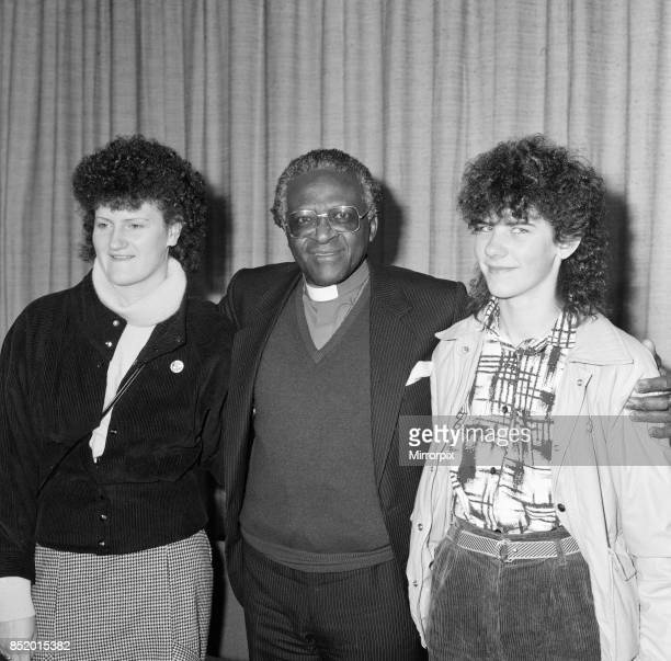Bishop Desmond Tutu at London Airport en route to Oslo to collect his Nobel prize flanked by Irish women Mary Manning and Karen Gearon 8th December...
