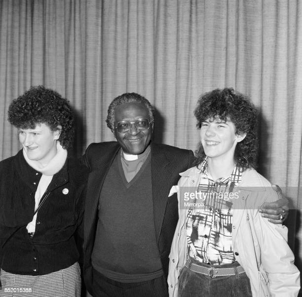 Bishop Desmond Tutu at London Airport, en route to Oslo to collect his Nobel prize, flanked by Irish women, Mary Manning and Karen Gearon, 8th...