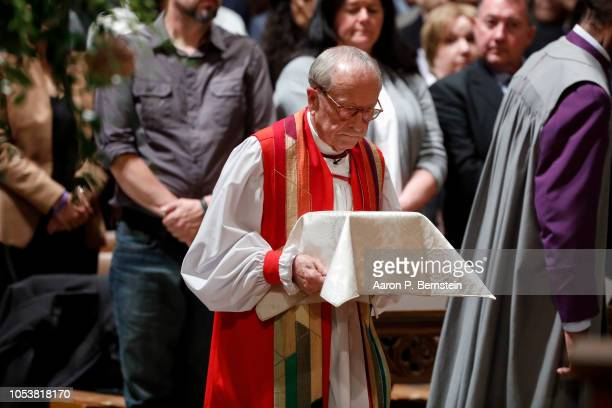 Bishop Gene Robinson carries the remains of Matthew Shepard at his memorial service at the National Cathedral on October 26 2018 in Washington DC...