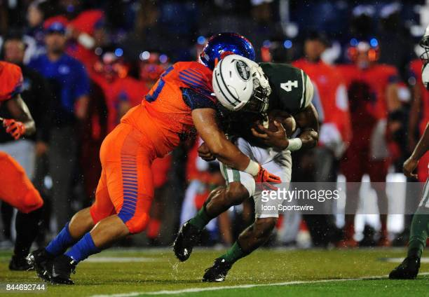 Bishop Gorman linebacker Andrew Ruelas tackles Miami Central running back James Cook in the second quarter of a prep football game between the Miami...