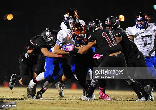 Bishop Gorman running back Biaggio Ali Walsh middle is brought down by Desert Oasis safety Keleb Ramsey and the rest of the Diamondbacks defense in...