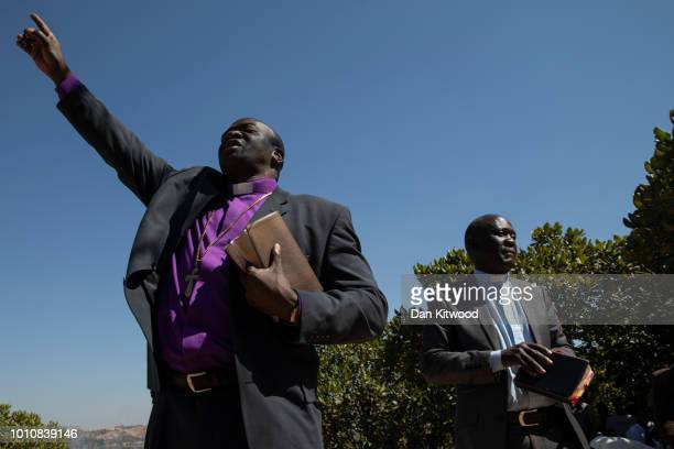 Bishop Guide Makore attends the funeral for Ishmael Kumire on August 4 2018 in Chinamhora Zimbabwe Ishmael was killed during deadly clashes on August...