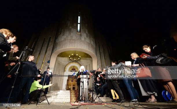 Bishop Hilarion who is in charge of the Russian Orthodox Church's diplomacy makes a statement in front of the building of the Minsk Eparchial...