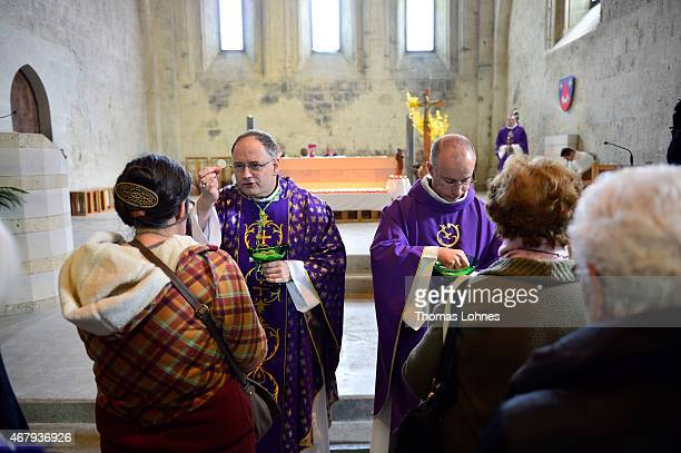 Bishop JeanPhilippe Nault leads a service for local residents remembering the victims of Germanwings Airbus fight near the crash site at Notre Dame...
